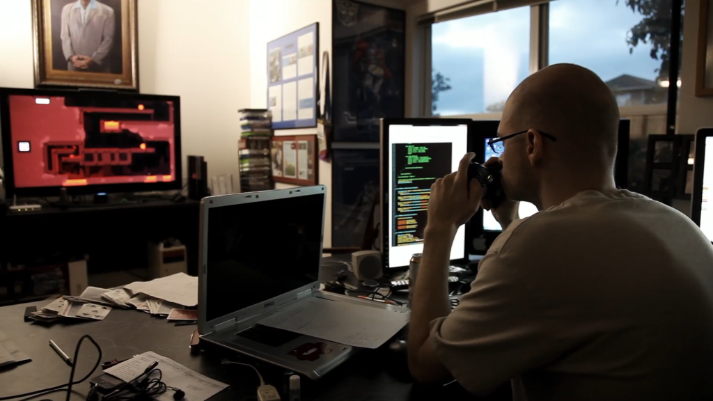 Tommy Refenes, independent developer, seen here working on Super Meat Boy. Screencap from Indie Game: The Movie (2012)