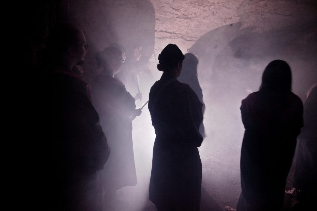 A summoning ritual in the basement. Photo by Natalia Kaniak.