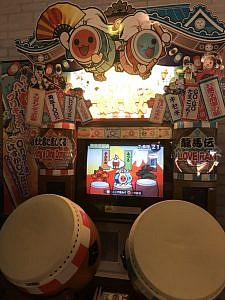 A Japanese taiko-drumming arcade game cabinet.