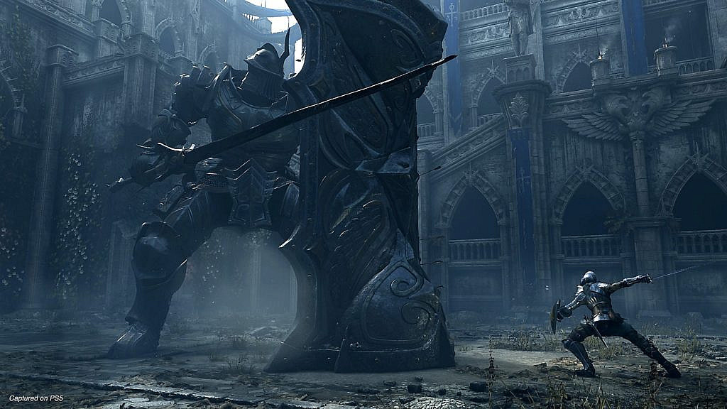 The main character facing a giant knight in the castle yard