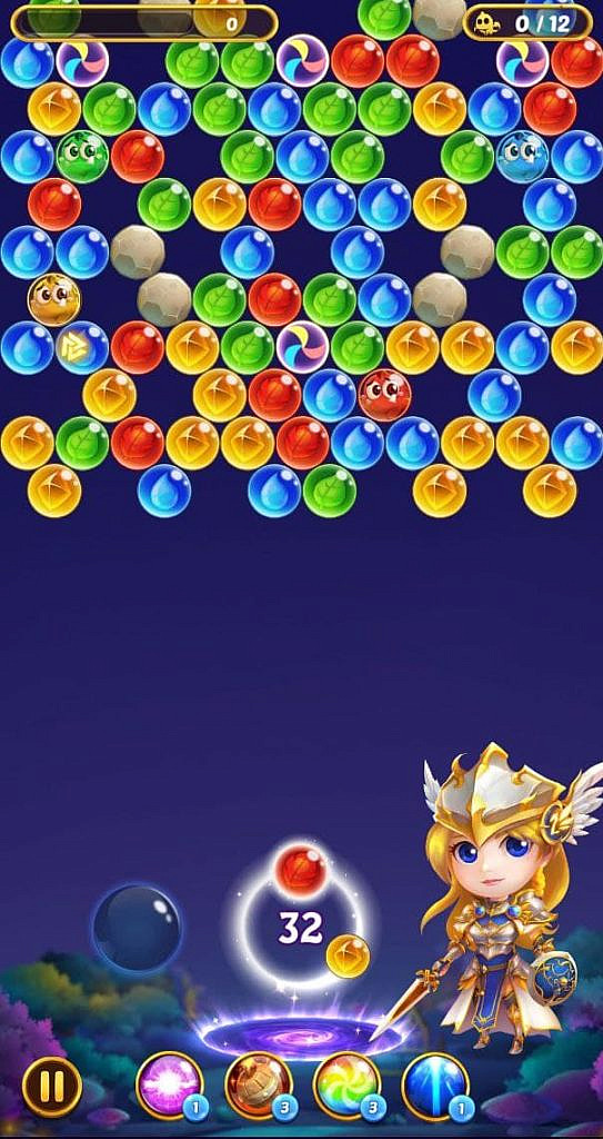 Colourful bubbles above the platform where the player shoots from. A decorative valkyrie stands beside the platform.