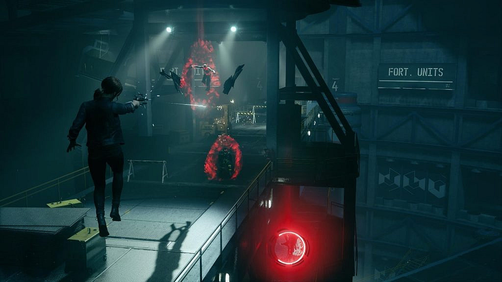 A main character with red hair shooting enemies with the weapon while levitating in the air