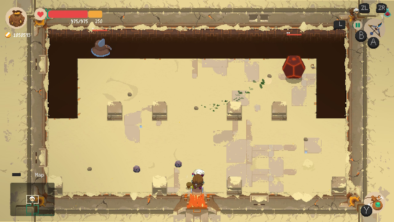 The main character Will from a bird perspective in a desert styled dungeon. A spherical enemy is in the upper right corner and a flying muppet on the left.