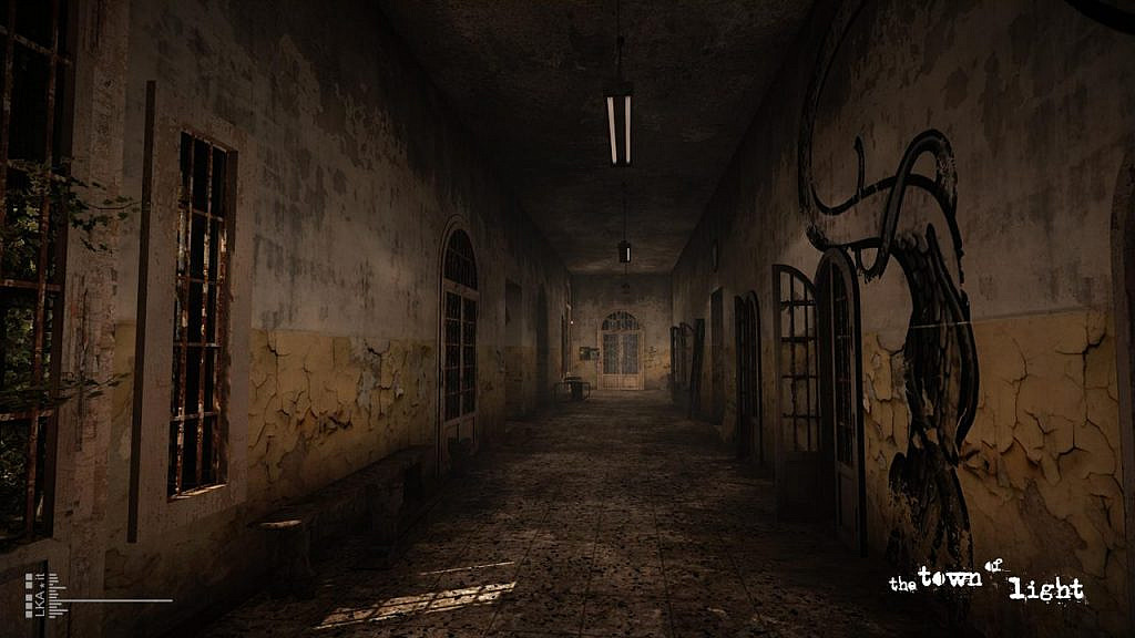 dilapidated dark hallway with cracked paint and graffiti