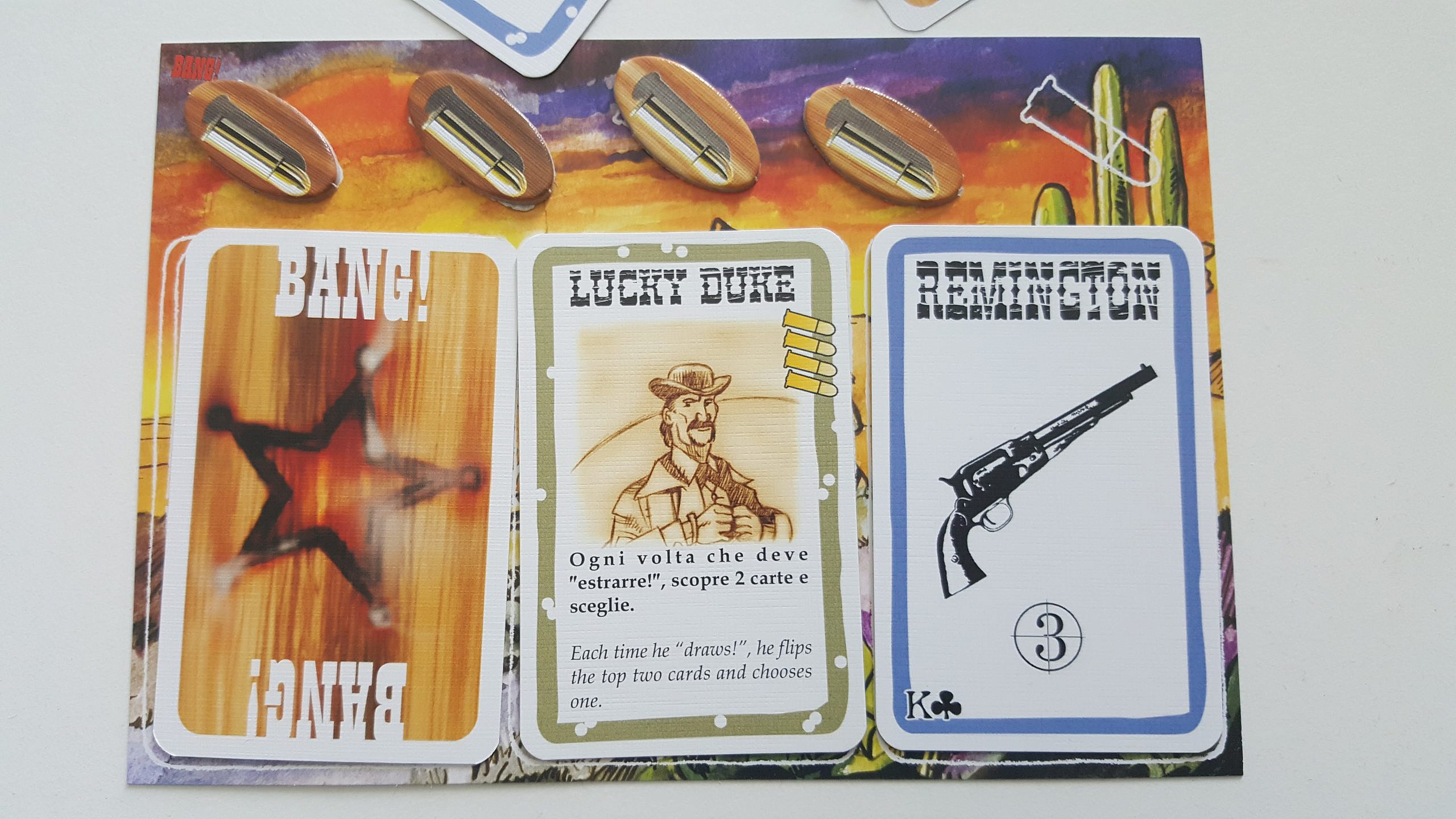 A player's role card, character card, weapon card and health (bullets)