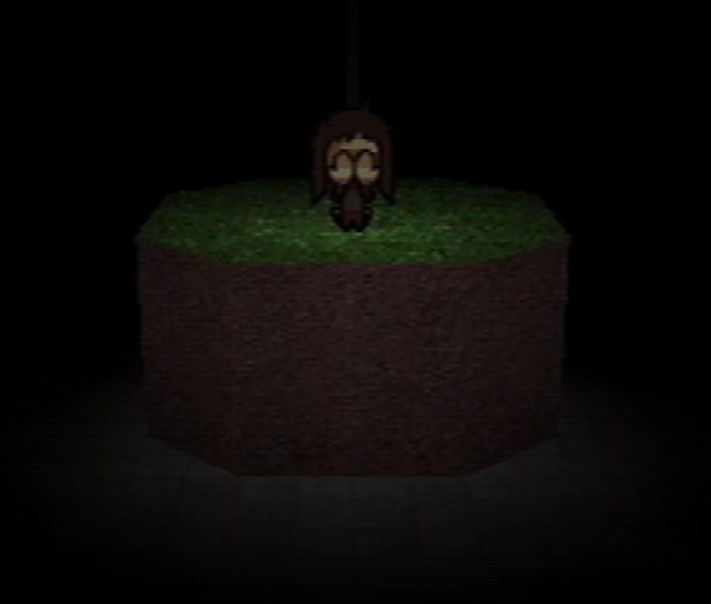 A pixelated girl is covering is burying her face in her hands, perhaps crying. She is sat atop an elevated structure of dirt and grass, sat in a black void.