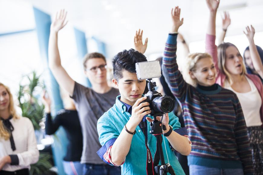 Students with a professional photographer