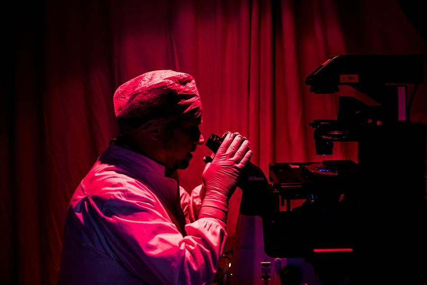 man at a microscope