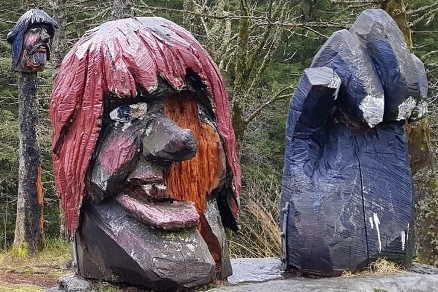 Two troll statues outside in a forest in Bergen, Norway. Photo by Usva Friman.