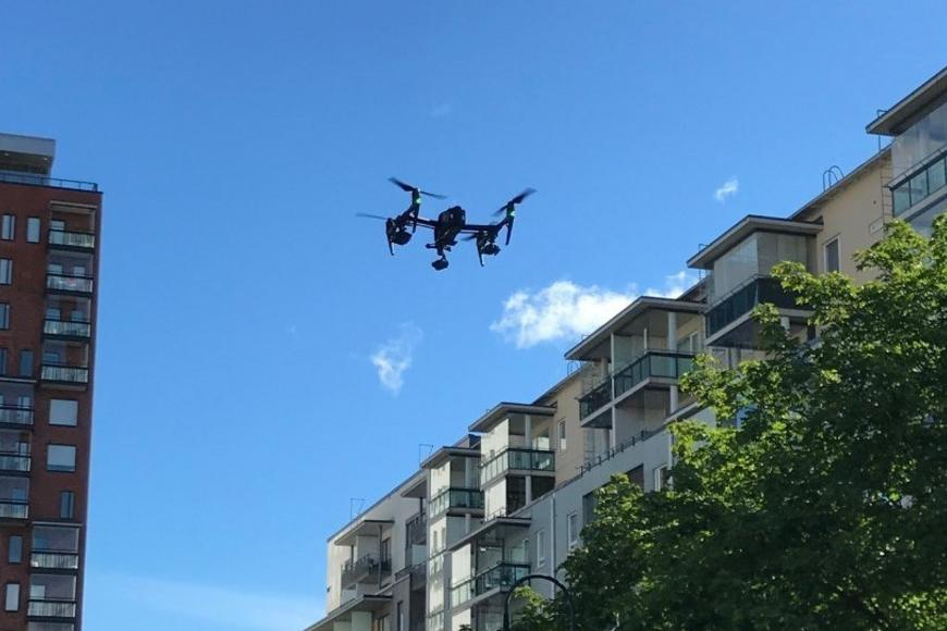 Drone flying in urban area