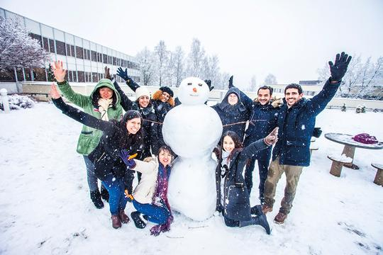 Students with a snowman